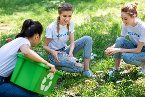 female volunteers with recycling box