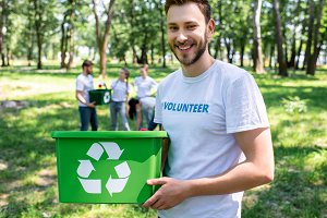 young smiling volunteer with green r