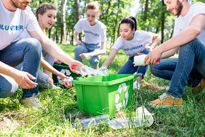 young volunteers with recycling box