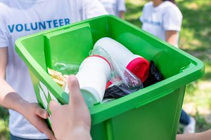 male volunteers with green recycling