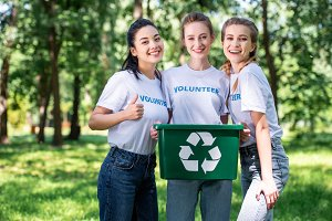 young female volunteers with recycli