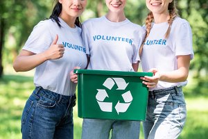 cropped view of young volunteers wit