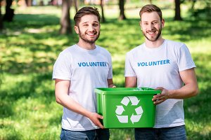 young male volunteers with green rec