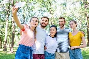 young smiling friends taking selfie