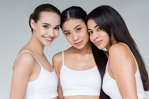 smiling multiethnic women looking at