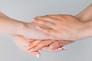 cropped view of girls holding hands