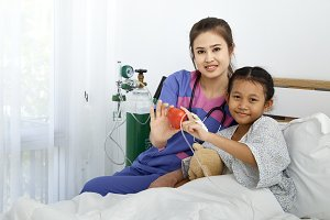 Doctor caring with love little girl