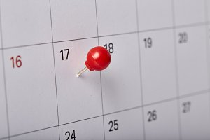 Red thumbtack tax day 201