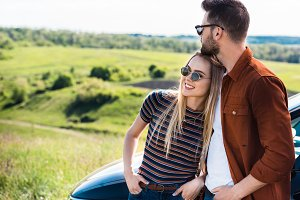 stylish young couple in sunglasses s