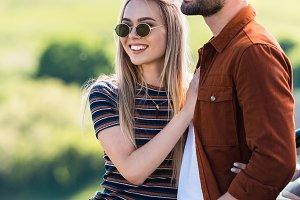 happy stylish couple in sunglasses s