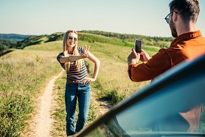man taking picture of girlfriend doi