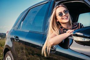 happy stylish woman in sunglasses le