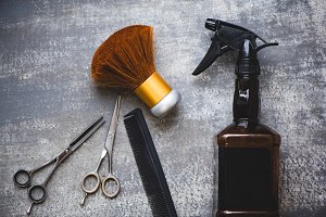 Hairdresser tools on a gray