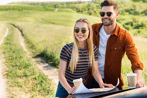 smiling stylish couple of travelers