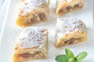 Slices of apple strudel on the white