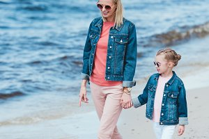 happy stylish mother and daughter ho