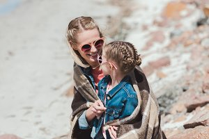 happy mother and daughter in sunglas