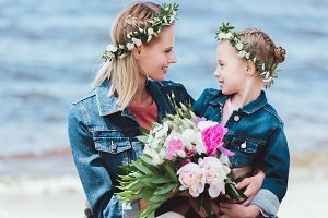 mother and daughter in floral wreath
