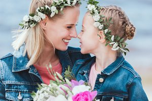 happy mother and daughter in floral