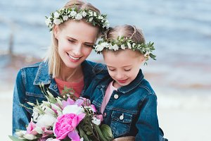 beautiful mother and smiling daughte