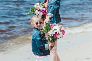 mother and daughter with peony bouqu