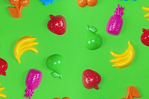 multicolored plastic toys fruits on