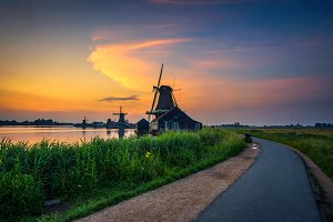 Sunset above historic windmills of