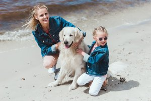 happy family with golden retriever d