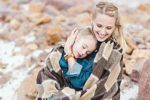 smiling mother hugging her adorable