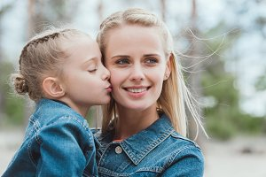 little adorable daughter kissing her
