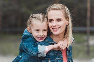adorable daughter hugging her smilin