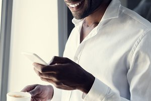 smiling young businessman in white s