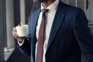 handsome young businessman with cup