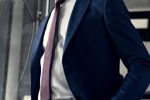 young businessman in stylish suit st