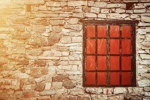 Old window in brick wall