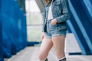side view of stylish woman in denim