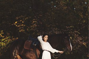 Beautiful woman with horse in the