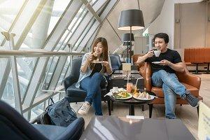 Asian couple sitting and eatting inn