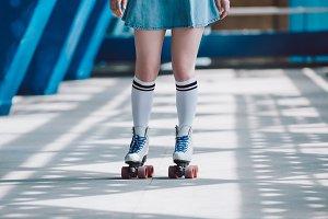cropped shot of girl in denim skirt