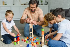 cheerful father and kids playing wit