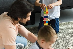 side view of father and kids playing