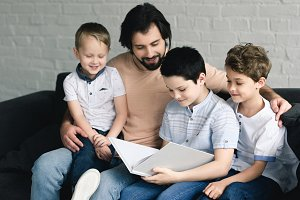 portrait of father and sons reading