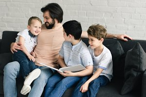 portrait of smiling father and sons
