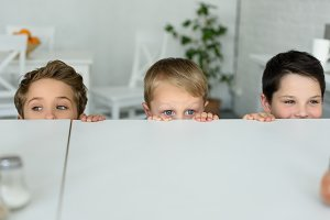 obscured view of little boys hiding