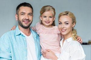 portrait of happy parents with adora