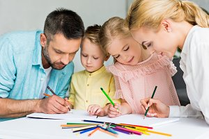 happy family drawing with colored pe