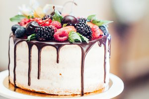 Wedding cake with strawberries, blac