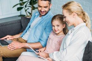 happy family using digital devices w