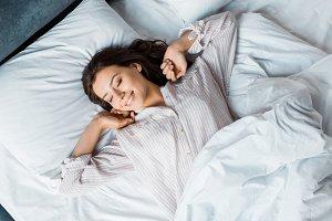 attractive young woman in pajamas wa