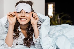 cheerful girl in sleeping eye mask l